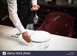 Setting The Table by Waiter Setting The Table Stock Photo Royalty Free Image 96896141