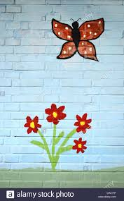 red flowers with a butterfly children s painting on a wall mural red flowers with a butterfly children s painting on a wall mural painting playschool