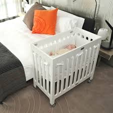 our co sleeping set up side car crib for the babies