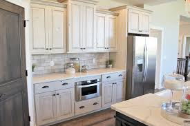 antique white farmhouse kitchen cabinets aspen homes antique white painted cabinets with gray