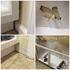 how to install base cabinets in laundry room laundry room makeover installing base cabinet saving the