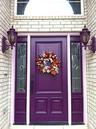 front doors a beautiful tree showing peak color stands out