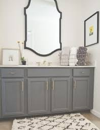 Vanity Merrick Gorgeous Bathroom With Gray Vanity Accented With Brass Hardware