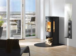 nice black metal stand alone fireplace in cool scandinavian home