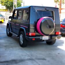 wrapped g wagon mercedes g wagon with pink accents and powder coated grille in