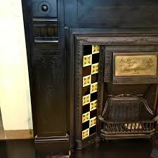 art nouveau antique tiled fireplace insert with copper hood