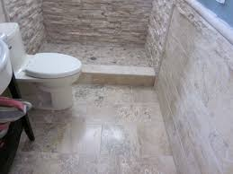 bathroom travertine bathroom with bath up and floating toilet for
