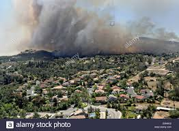 California Wildfires San Diego by Aerial View Of The Cocos Wildfire As It Burns The Foothills Stock