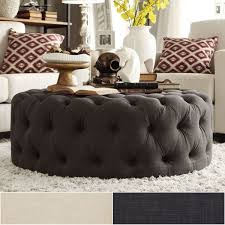 knightsbridge round tufted cocktail ottoman with casters by