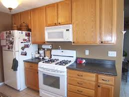 White Kitchen Cabinets Wall Color by Remodelaholic From Oak To Beautiful White Kitchen Cabinets In