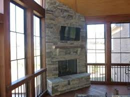 screened porch with an outdoor fireplace screened porches photo