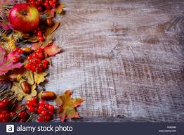 border of fruits and fall leaves on the wooden background stock