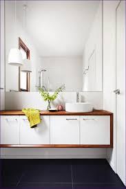 bathroom white bathroom with color accents black tiles design