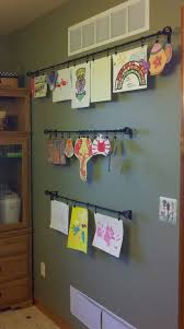 hanging kids artwork hang drapery rods on your wall to display kids artwork drapery rods