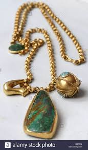 small turquoise pendant necklace images Detail image of long gold chain turquoise pendant and bird jpg