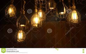 retro light bulb lighting series lights with brick wall stock
