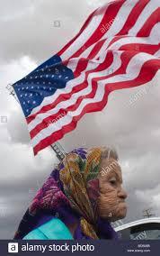El Paso Texas Flag An Elderly Woman Walks Underneath A Gigantic Us Flag On The Side