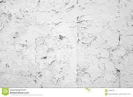 cracked flaking white paint on old stone wall stock photo image