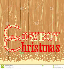 cowboy christmas text on wood texture background stock photography