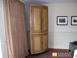 19th century american paint decorated corner cabinet