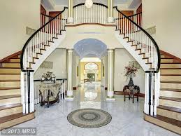 traditional staircase with barrel vault ceiling u0026 marble floors in