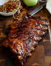 sticky maple apple ribs with shoestring fried apples running to