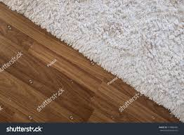 Laminated Wood Floors Closeup White Carpet On Laminate Wood Stock Photo 717886450