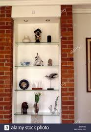 up of ornaments on glass shelves with brick pillars in