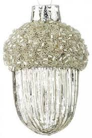 this vintage glass ornament is silver and with white
