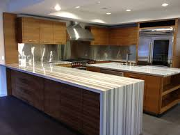 White Kitchen Island With Stainless Steel Top by Kitchen White And Black Waterfall Edge Spice Maple Kitchen