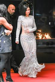 kylie jenner forgoes undergarments in metallic see through gown at