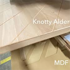 what is the difference between mdf and solid wood is mdf or solid knotty alder better for your modern