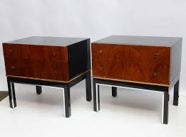 pair of black lacquered and walnut nightstands by american of