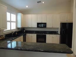 white kitchen cabinets dark trim small apartment kitchen