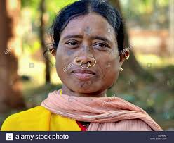 middle aged indian adivasi market woman with tattoos three