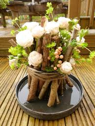 35 best summer table decoration ideas and designs for 2017 woodland themed sticks twine and posies table centerpiece