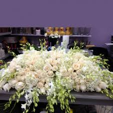 casket spray all white casket spray garden of kisses