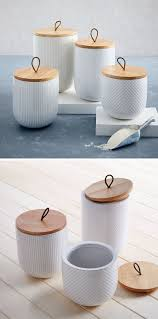 keep your food and decor fresh with these 13 modern jars and with wood lids that have leather tabs these white stoneware canisters have individual textured patterns making you want to reach out and grab them