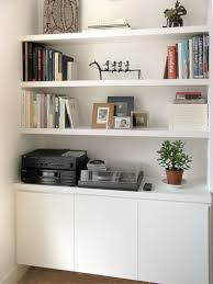 alcove shelves with cupboard storage above skirting boards