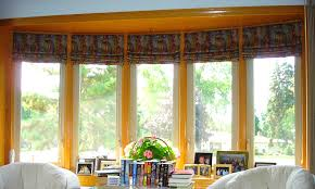 Blinds For Bow Windows Decorating with Roman Shades In Fabric Inside The Curve Of This Bow Window Bow