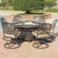 round grey metal carving fire pit dining table added by six black