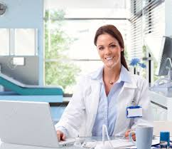 Front Desk Secretary Jobs by Happy Female Caucasian Doctor At Office Sitting In Front Of Laptop