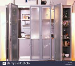small spaces kitchen in cupboard with sliding doors overall