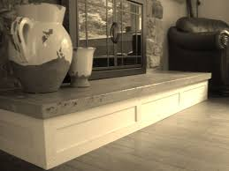 handmade concrete hearth and custom mantel by northeast furniture