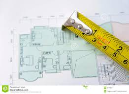 rolls of architectural house plans u0026 tape measure royalty free