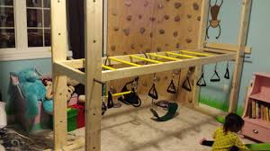 indoor rock climbing wall with adjustable monkey bars