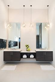 Modern Bathroom Wall Sconces On Frameless Mirror With Single Sink - Modern bathroom vanity designs