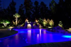 low voltage lighting near swimming pool swimming pool and grotto illuminated at night with low voltage