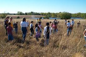 planting native grass seed sneed prairie field trip program