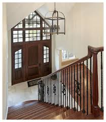 Dining Room Entryway by Dining Room Farmhouse Chandelier With White Wall And Wood Door